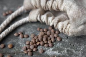 Lentils spilling out of a bag